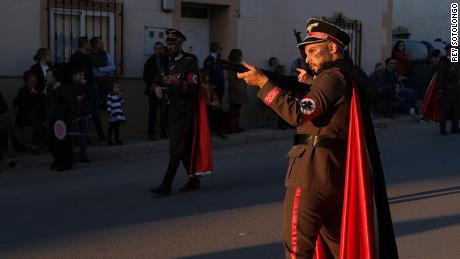 A man dressed as a Nazi soldier poses with gun at a carnival parade in Campo de Criptana, Castile-La Mancha, Spain on February 24, 2020.
