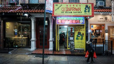 A woman walks by Chinatown Ice Cream Factory, a neighborhood fixture owned by Christina Seid and built by her father four decades ago in New York on February 13, 2020.