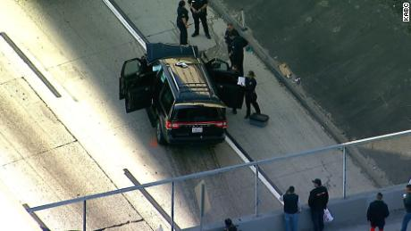 Police surround the hearse that was stolen from Pasadena.