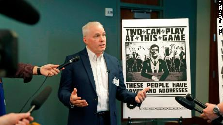 Chris Ingalls, an investigative reporter with KING-TV in Seattle, talks to reporters on Wednesday about the poster, reproduced at right, that was mailed to his home earlier this year.