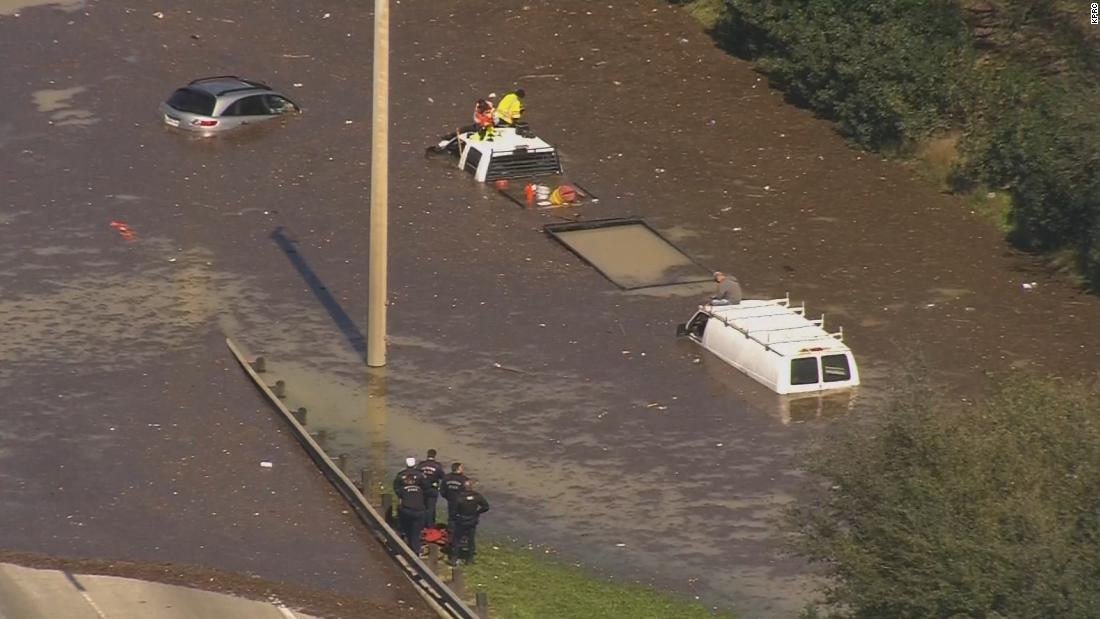 Houston water main break causes major flooding, submerging cars and filling streets