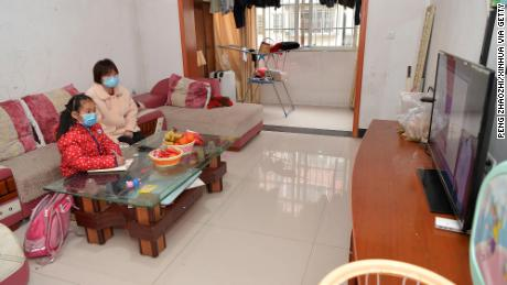 A student attends an online class at home in Nanchang City, in east China's Jiangxi Province, February 10, 2020.