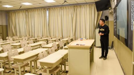 Teacher Zhang Weibao shoots a video course at a middle school in Urumqi, northwest China's Xinjiang Uygur Autonomous Region, on February 3, 2020.