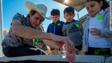 Kimbal Musk teaches students how to plant a vegetable garden in California.