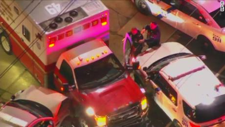 Police officers approach a stolen ambulance in Philadelphia but the man driving the ambulance managed to drive away. He was later apprehended by police.