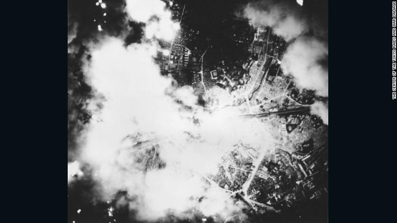 Smoke and fire rise from Tokyo during the US firebomb raid.