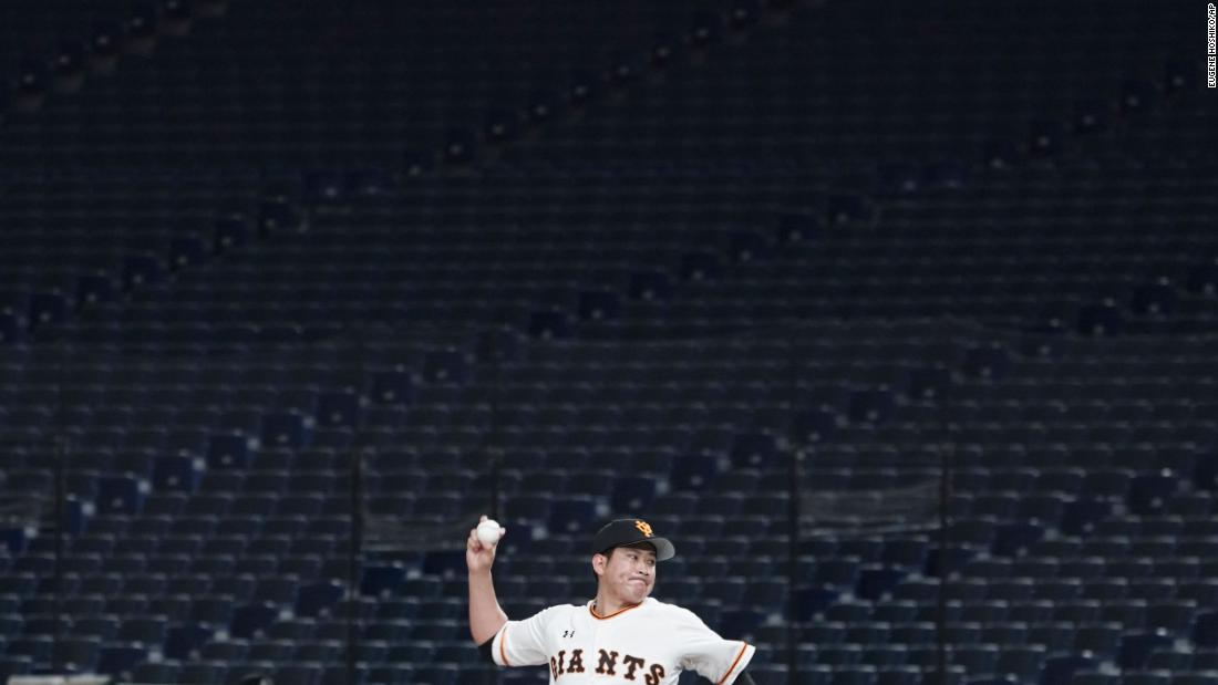 Tomoyuki Sugano, a professional baseball player on the Yomiuri Giants, throws a pitch in an empty Tokyo Dome during a preseason game on February 29. Fans have been barred from preseason games to prevent the spread of the coronavirus.