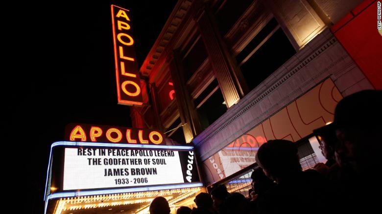 People line up to pay their respects to James Brown during a public viewing at the Apollo Theater in New York in 2006.