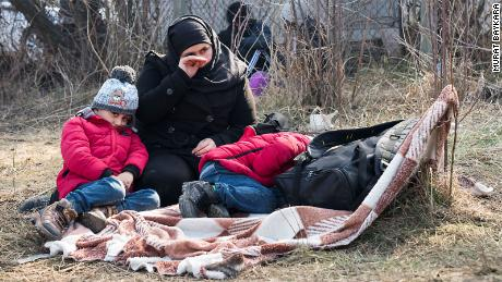 Migrants rest at the Pazarkule Border post between Turkey and Greece.