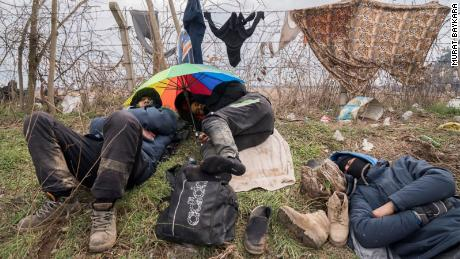 Migrants bunker down in miserable conditions at the Pazarkule Border post.