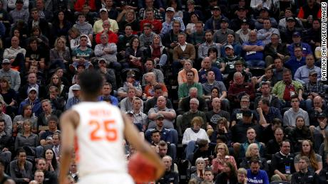 Crowds like this one, watching Syracuse play Baylor in March 2019, could be absent in this year's NCAA tournaments after a players' advocacy group requested empty arenas.