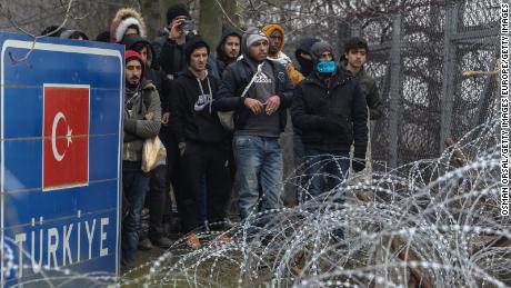 Migrants gather at Pazarkule border as they attempt to enter Greece from Turkey on February 29.