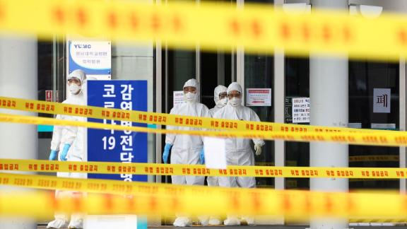 Medical staff stand outside a hospital in Daegu, South Korea, on March 1.