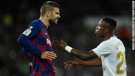 Gerard Pique clashes with Vinicius Jr. during El Clasico.