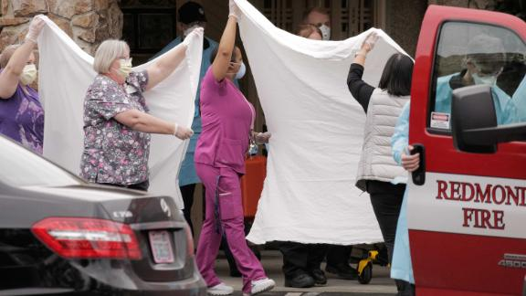 Healthcare workers transfer a patient at the Life Care Center in Kirkland, Washington, on March 1. The long-term care facility is linked to confirmed coronavirus cases.