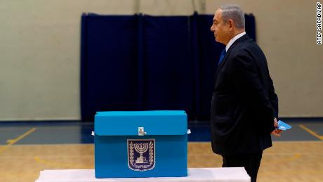 Israeli Prime Minister Benjamin Netanyahu prepares to cast his ballot during the Israeli legislative elections at a polling station in Jerusalem, Monday, March 2, 2020. Israelis have begun voting in the country's unprecedented third election in less than a year. (Atef Safadi/Pool Photo via AP)