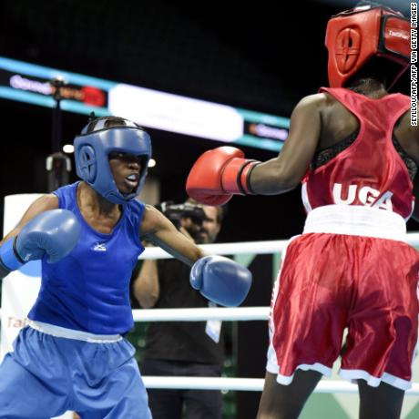 Kenya's Christine Ongare (Blue) fights against Uganda's Catherine Nanziri (Red) during the women's Fly finals at the Dakar arena on February 29, 2020 in Dakar, Senegal.