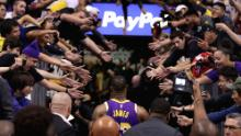 LeBron James #23 of the Los Angeles Lakers walks off the court past fans following the NBA game against the Phoenix Suns at Talking Stick Resort Arena on November 12, 2019 in Phoenix, Arizona.