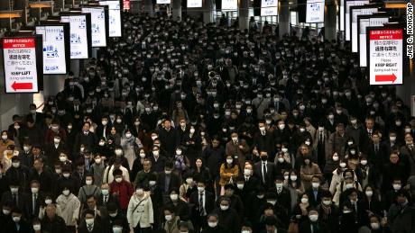 A large crowd wearing masks commutes through Shinagawa Station in Tokyo, Tuesday, March 3, 2020. The Japanese government has indicated it sees the next couple of weeks as crucial to containing the spread of COVID-19, which began in China late last year.