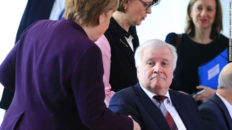 German Interior Minister Horst Seehofer refuses shaking hands with German Chancellor Angela Merkel in Berlin, Germany on March 2, due to the spread of coronavirus.