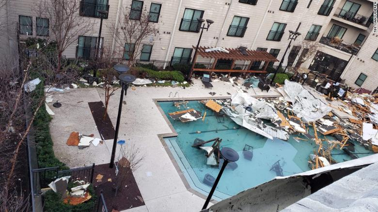 Storm debris is strewn across an apartment swimming pool in the Germantown area of Nashville.