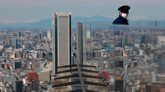 A security guard stands on the Shibuya Sky observation deck in Tokyo on March 3.
