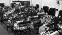 In 1942, these factory workers cleaned Merlin engines to be used in bombers and fighter aircraft.
