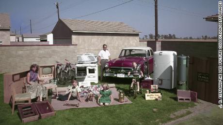 An American family, posing in their yard in Los Angeles in 1952.