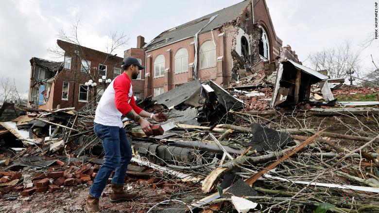 Sumant Joshi helps to clean up rubble at a Nashville church Tuesday.