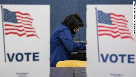 A voter fills in her ballots for the Democratic presidential primary election at a polling place in Armstrong Elementary School on Super Tuesday, March 3, 2020 in Herndon, Virginia.