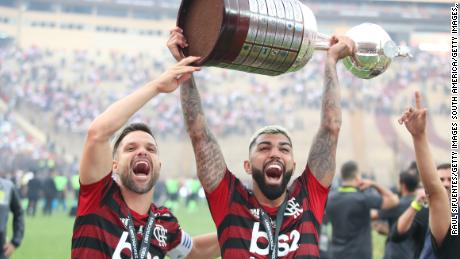 Gabriel Barbosa lifts the Copa Libertadores trophy after his two late goals beat River Plate.