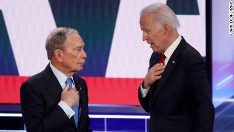 Democratic presidential candidates, former New York City Mayor Mike Bloomberg, left, and former Vice President Joe Biden talk during a break in a Democratic presidential primary debate Wednesday, Feb. 19, 2020, in Las Vegas.