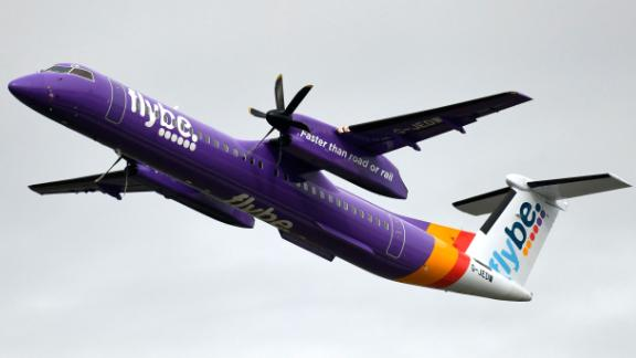 This picture shows a Dash 8 Q400 of Flybe airline during take-off on September 24, 2019 at the airport in Duesseldorf, western Germany.
