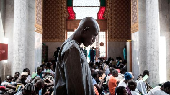 A Muslim worshipper attends a mass prayer against coronavirus in Dakar, Senegal, on March 4. It was after cases were confirmed in the country.