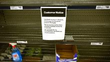A notice posted on empty shelves of hand sanitizer in a supermarket in Sydney on Wednesday.