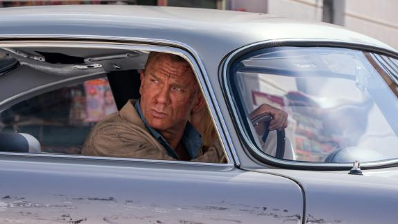 """James Bond (Daniel Craig) and Dr. Madeleine Swann (Léa Seydoux) drive through Matera, Italy in """"No Time To Die"""", an EON Productions and Metro Goldwyn Mayer Studios film. (Photo by Nicola Dove © 2020 DANJAQ, LLC AND MGM.  ALL RIGHTS RESERVED.)"""