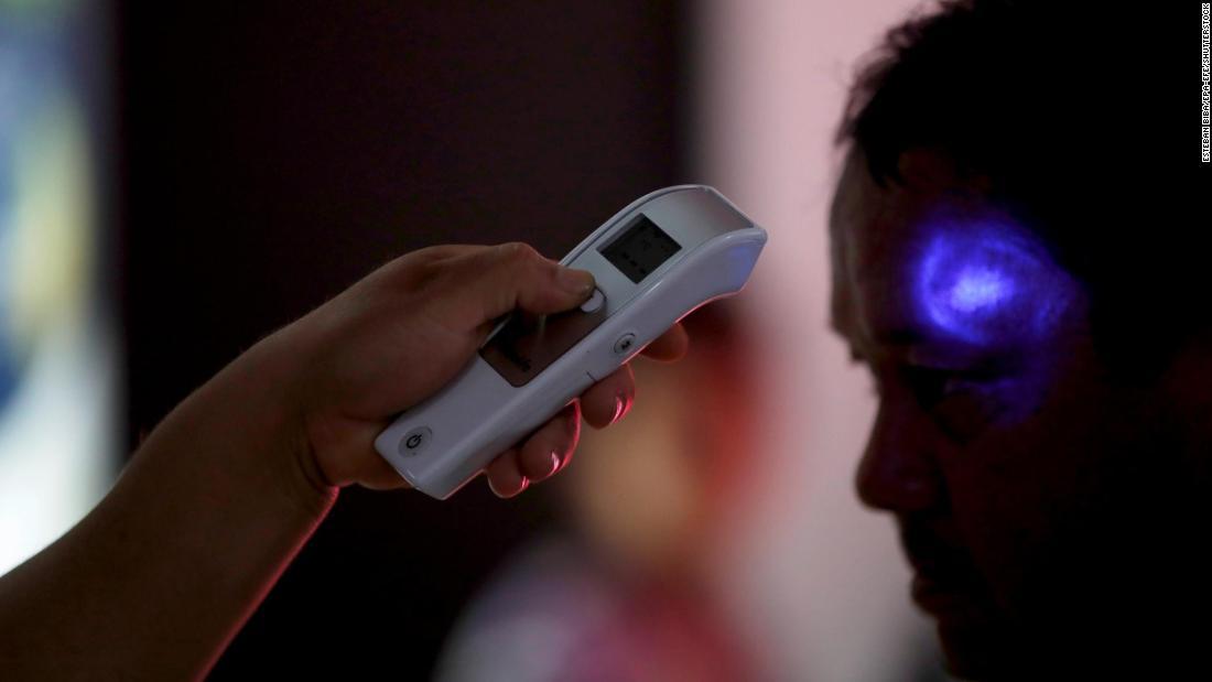 Coronavirus symptoms usually take 5 days to appear, study says - CNN