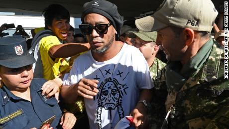 Brazilian ex-football star Ronaldinho arrives at Silvio Pettirossi International Airport in Luque, near Asuncion, on Wednesday.