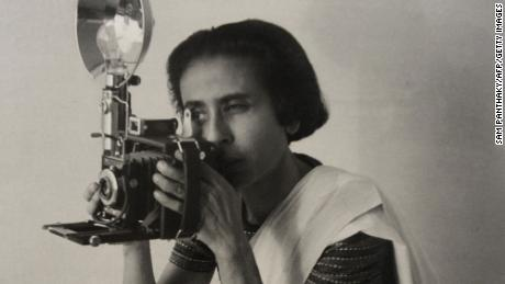 "This reproduction of a picture from the Homai Vyarawala's collection shows Indian photographer Homai Vyarawalla in her early years. The picture was published in the book ""India In Focus : Camera Chronicles of Homai Vyarawalla"" authored by Sabeena Gadihoke. Vyarawalla, 98, died on January 15, 2012 in Vadodara. Vyarawalla photographed the last days of the British Empire and her work traces the birth and growth of a new nation. Vyarawalla was recently conferred Padma Vibhushan, India's second highest civilian honour   AFP PHOTO / Sam PANTHAKY (Photo credit should read -/AFP via Getty Images)"