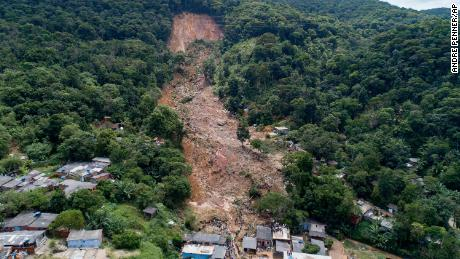Trees are gone after a mudslide triggered by heavy rains in the coastal city of Guaruja.