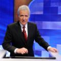 "Game show host Alex Trebek poses on the set of the ""Jeopardy!"" Million Dollar Celebrity Invitational Tournament Show Taping on April 17, 2010 in Culver City, California."