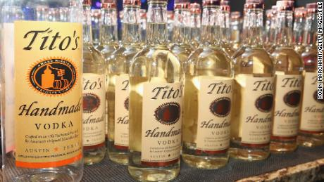 No, using Tito's Vodka does not replace washing your hands.