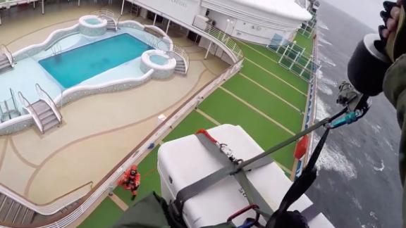 "Airmen from the California National Guard drop coronavirus testing kits down to the <a href=""https://www.cnn.com/2020/03/05/health/california-coronavirus-cruise-ship-thursday/index.html"" target=""_blank"">Grand Princess cruise ship </a>off the coast of California on March 5."