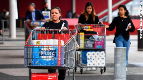 'It's crazy': Panic buying forces stores to limit purchases of toilet paper and masks