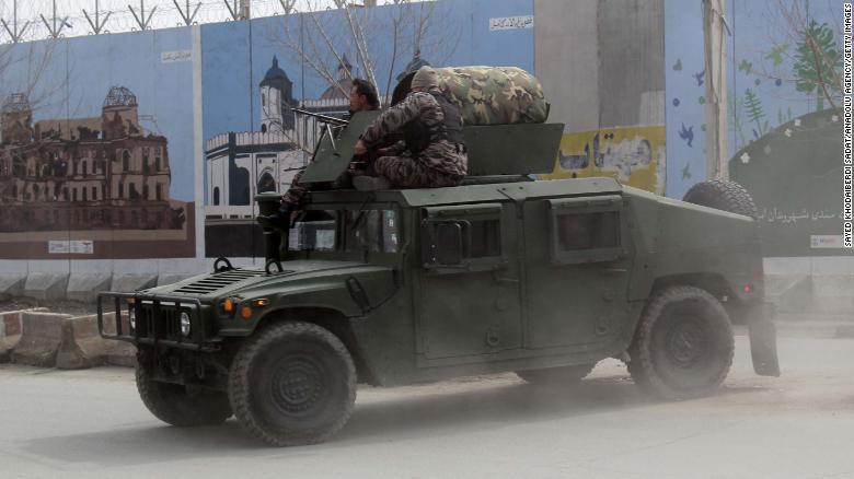 Afghan security forces patrol after Friday's attack in Kabul.