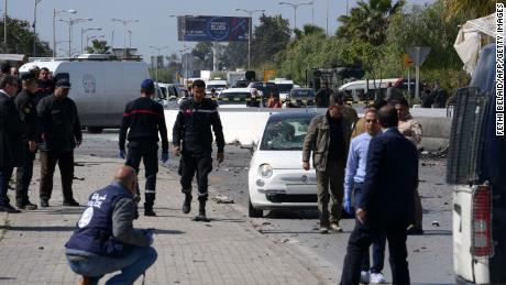 Police and forensic experts gather at the scene of an explosion in the Tunisian capital Tunis on March 6, 2020. - A blast that rocked Tunis today was an attack that targeted the US embassy and caused injuries among policemen, police said.