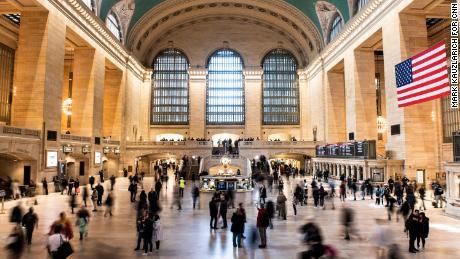 People walk through Grand Central Terminal, a major transit hub.