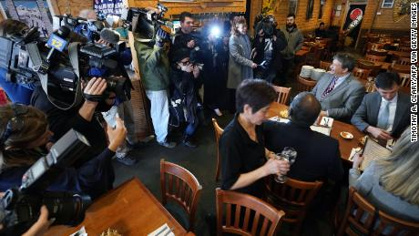 Westchester County Executive George Latimer, center, and New Rochelle Mayor Noam Bramson, right, are surrounded by the press as they eat lunch at Eden Wok Kosher Chinese in New Rochelle, New York, on March 5, 2020.