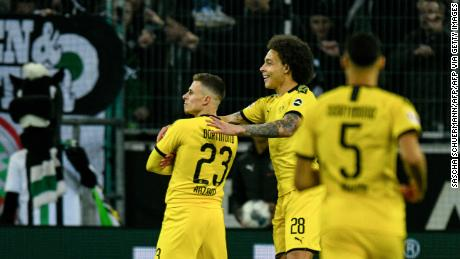 Dortmund's Thorgan Hazard celebrates his goal with his teammate and fellow Belgian midfielder Axel Witsel.