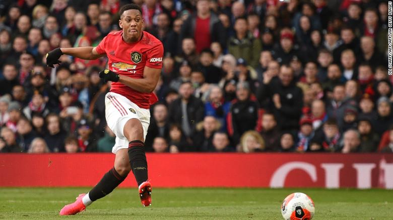 Striker Anthony Martial scores the opening goal for Manchester United.